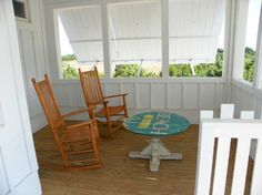 Ocracoke beach house. Front Porch with board and batten and shutters