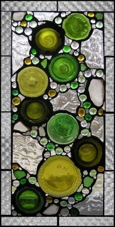 .Wall hanging with bottle bottoms