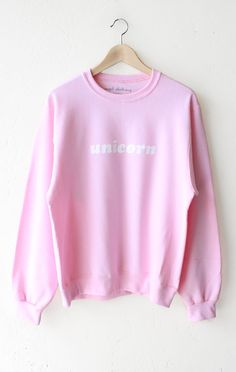 "- Description Details: 'Unicorn' oversized sweater in pink. Brand: NYCT Clothing. Unisex/Oversized fit Measurements: (Size Guide) XS/S: 40"" bust, 25"" length, 24.5"" sleeve length M/L: 44"" bust, 26"" len"