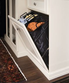 Walk-in Closet Tilt-out Hamper - - - new york - by transFORM | The Art of Custom Storage