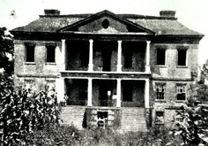 Post-Civil War landfront view of Drayton Hall. Years of neglect are apparent in the missing pediment, broken windows, and corn growing up to the portico. (http://www.draytonhall.org)