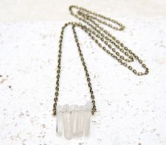"""A pendant style necklace composed of five translucent white crystal stones strung from an antique gold chain necklace. Each stone is unique, no two will be exactly alike. Lead and Nickel free.<br><br>White Crystal<br>Size: 38.5"""""""