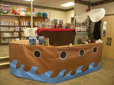 Library circulation desk converted into pirate ship. Library Themes, Library Activities, Library Displays, Library Ideas, Pirate Decor, Pirate Theme, Library Boards, Children's Library, Teach Like A Pirate