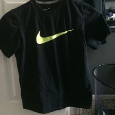 Nike shirt Size medium is shrunk a little so fits like a small no holes no fading and the Nike emblem is a neon yellow Nike Tops