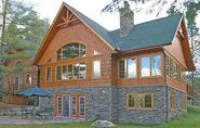 stone exterior on log home by confederate homes