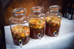 Pimms fruit cocktail served in a large Kilner drinks dispenser for guests to help themselves