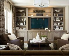 neutral living room. Nice ring handles on the doors.
