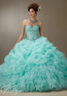 Matching Bolero Jacket included.Colors available: Pink, Light Aqua, Coral and White. Quinceanera Dresses and 15 Dresses by Designer Madeline Gardner.