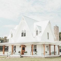 gardens architecture I love how it looks a bit like a church. I love how it's white. I love how it looks a bit like a church. I love how it's white. I love the natural wood posts and the wrap around porch. House Wrap Around Porch, House With Porch, My House, Ranch Houses With Wrap Around Porches, House Floor, Dream House Exterior, Dream House Plans, My Dream Home, Pole Barn House Plans