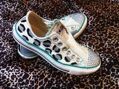 White Converse with bedazzled tops and hand-painted leopard print.