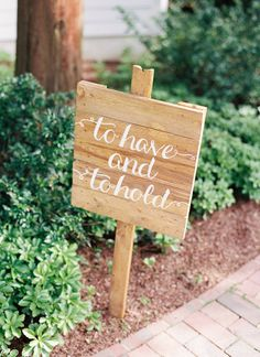 wooden signs leading to the ceremony | Nancy Ray Photography #wedding