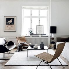 A livingroom of #arnejacobsen and #poulkjaerholm. Photo by @elledecorationdk. #fritzhansen