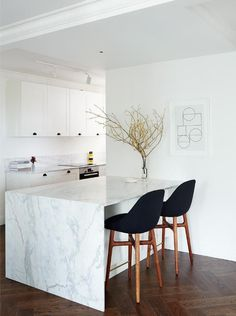 i like the simple white shaker cabinets with the black hardware.
