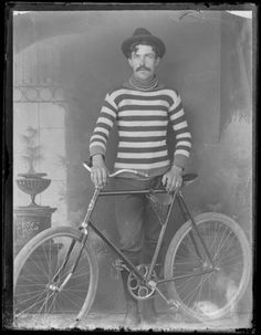 Man with a bicycle   Date: [between 1895 and 1910]   Creator: Bartle Brothers   Format: Glass plate negative