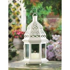White Candle Moroccan Lantern Creamy white sparks up the night, adding fresh appeal to the traditional Moroccan candle lantern. Clear glass panels showcase a candle's dancing glow, for a total look of