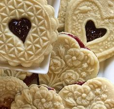 We often think of Linzer Cookies as just for Christmas. But these wonderful soft and tender almond butter cookies will complement any Valentine cookie platter. The subtle nutty flavor comes from the ground almond flour in the dough. The fruit fillings are enhanced by lemon zest. Raspberry is the traditional flavor for the filling. …