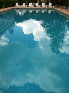 """Reflections in the pool of the Grand Hotel, Rimini #cloudporn"" by @SuuperG"