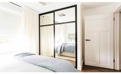 Door, door handles and black frame mirror robe - Reno Rumble Inspo