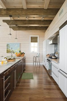 Love the white and espresso contrast and the exposed wood beams