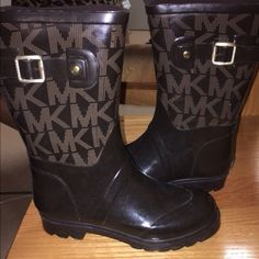 Michael Kors Rain Boots. Size 6 Love them, but they're just a bit too small for my liking. Bought on Posh, and was told they were 6 1/2, which is what I wear. But when they were too tight, I did some checking and I see they only come in full sizes. Reposhing for what I paid for them. Cute buckle accent. Jersey lining. Logo printed upper. Cute boots! Michael Kors Shoes Winter & Rain Boots