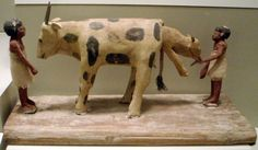 Ancient Egyptian tomb figurines and a birthing cow. Dates to the early Middle Kingdom, circa 2000 BC.