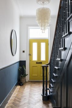 Interior Design by Imperfect Interiors at this Victorian Villa in London. A palette of contemporary Farrow & Ball paint colours mixed with traditional period details- Hague Blue spindles, staircase and white walls, a sunshine yellow front door, a large me Hallway Colours, Hallway Colour Schemes, Yellow Hallway, Black And White Hallway, Bright Hallway, Dark Hallway, Blue Hallway Paint, Blue Yellow Living Room, Blue Living Rooms