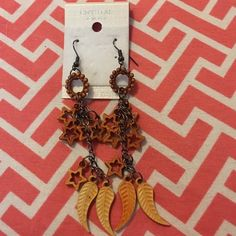 Very cute stars and leaves dangling earrings. Different color of orange dangling stars and leaves earrings new never been worn. Jewelry Earrings