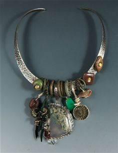 """Allison Bellows: """"Sterling Silver, Oregon Moss Agate, Ammonite, Baby Geode, Chrysoprase, Dinosaur Bone, Native Copper, Tourmaline, Ancient Celtic Rings. Sterling Silver Hard Collar that is open on the top and very comfortable to wear!""""  $1025.00 © Allison Bellows"""