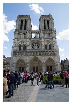 A lot of persons waiting to enter Notre Dame in Paris, France...