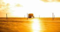 Plage des Chalets après un coup de mer, de l'or sur le sable par Jérôme