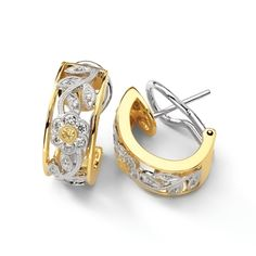Flower Collection - These striking 18K white and yellow earrings are comprised of .23ctw round white Diamonds and .04ctw round yellow Diamonds. - ME1487