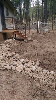 Drainage Swale for all the water from property to drain away from house in Durango Co Landscaper Gardenhart Landscape & Design We mitigate drainage problems