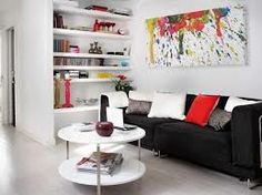 This living space works well as it incorporates  shelving and a table.Giving more storage space in a living space.