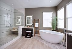 Like the pebble under tub and in showeTile That Looks Like Wood - The Definitive Buyers Guide | HomeFlooringPros.com