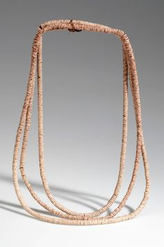 Botswana | 3 strand necklace from the Kung Bushman from Western Ngamiland/Dobe | Ostrich shell beads, seed and cord | ca. 1971