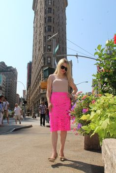 Caitlin Hartley of Styled American, girl in front of flat iron building in hot pink lace skirt http://styledamerican.com/favorite-looks-of-2015/