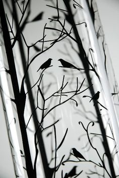 Glass vase with trees and birds.