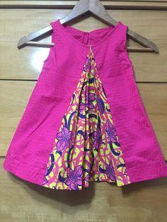 Little girls' dress with fan pleat detail in African ankara fabric
