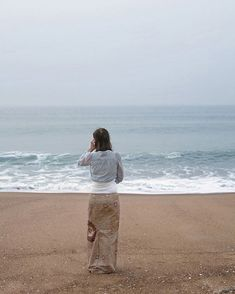 Is this woman wading in the sea?