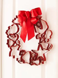 Use cookie cutters to form a wreath shape, and attach the cutters together with hot glue. Spray-paint the wreath in brilliant Christmas red and add a bow for festive flair.