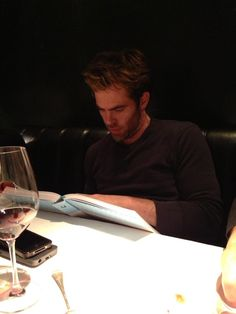 Jamie Byng: Love this photo of Chris Pine/Captain Kirk utterly engrossed by Letters of Note at our dinner for JJ Abrams  11/14/2013  (852×1136)