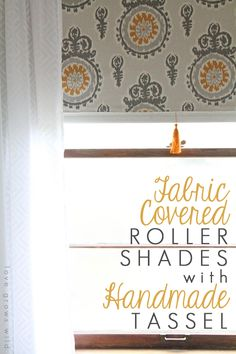 Another good tutorial about covering roller blinds with Fabric :: How to make a Fabric Covered Roller Shade with Handmade Tassel