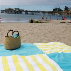 Sew a few towels together, and attach a table clothe underneath to create a BIG beach blanket <3