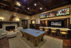 Traditional Game Room with Box ceiling, High ceiling, Cement fireplace, Wall sconce, Carpet, Hardwood floors