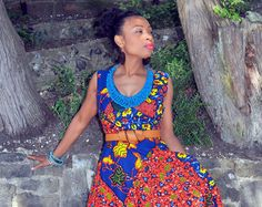 Items similar to Purple african print full skirted dress with, bell sleeves and deep side pockets. on Etsy Full Skirt Dress, Bell Sleeve Dress, Dress Up, Bell Sleeves, Tight Dresses, Fall Dresses, High Collar Dress, Weather Wear, African Print Dresses