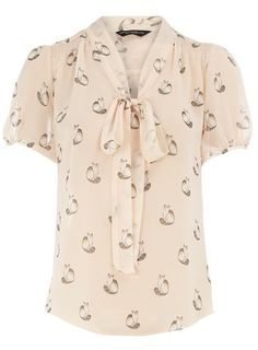 Cat-print blouse.