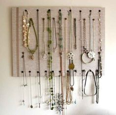 Cover a corkboard in linen for a flexible necklace display.