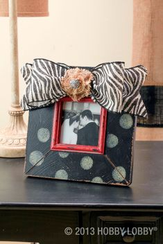 Add animal-print burlap ribbon to a photo frame for instant style.