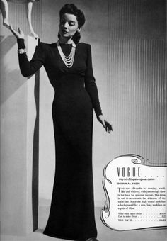Big fan of these long, black, slimming dresses with padded shoulders and a bold, rich accessory. very sophisticated and classic.