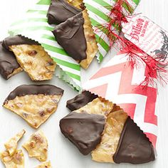 Chocolate Almond Brittle - A Favorite! 12/10/15 - I make this every year for Christmas because it is so simple to make and makes a great treat. No candy thermometer needed with this recipe, just a microwave. You do have to work quickly once this comes out of the microwave and you are spreading it on cookie sheet but other than that, it really is easy. I have never used anything other than almonds because that is what my family prefers but I bet macadamia nuts would be over the top in this recipe.
